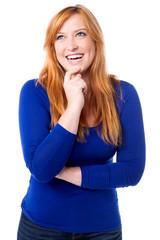 Young laughing woman imagining something