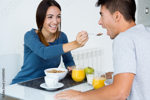 Young Couple Enjoying Breakfast in the kitchen