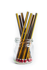 Unsharpened Pencils in a jar on a white background