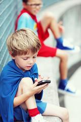 Little Superhero with smartphone