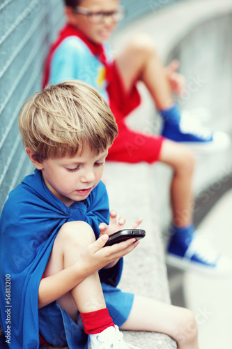 Little Superhero with smartphone
