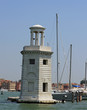 lighthouse on the island of San Giorgio in Venice and port