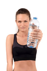 Girl holding a bottle of water offering you to drink.Hydration