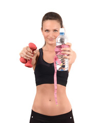 Fit girl with water and weights.Blur model,focus objects.