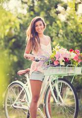 Beautiful young woman on bike