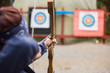 Brunette about to shoot arrow