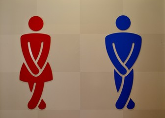 Toilet sign with a man and a woman