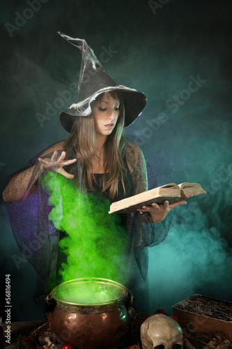 Halloween witch cooking a potion in a cauldron