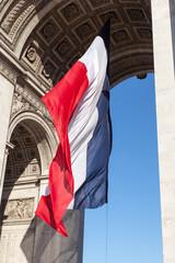 French flag in Paris Triumphal arch.