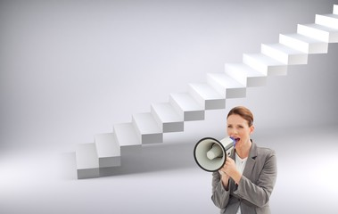 Composite image of serious businesswoman talking on a megaphone
