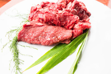 closeup of some raw beef fillets  on a white background