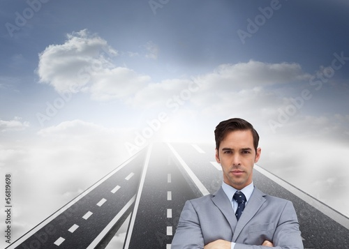 Young businessman looking at camera standing on streets