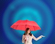 Attractive businesswoman holding umbrella