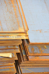 Stacked rusty steel metal sheet, ready for shipment in port