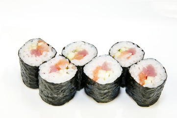 Japanese rolls in a restaurant with fish and vegetables
