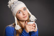 Winter woman wearing warm clothing holding a cup