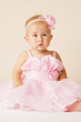 Little baby girl in pink dress.