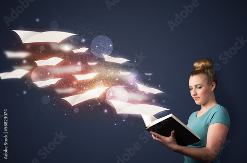 Young lady reading a book with flying sheets coming out of the b