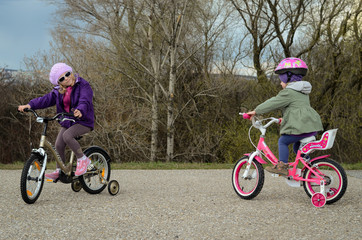 two girl riding a bike