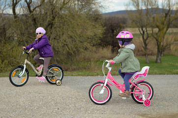 two girls riding a bike