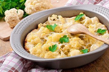 cauliflower baked with egg and cheese with green peas
