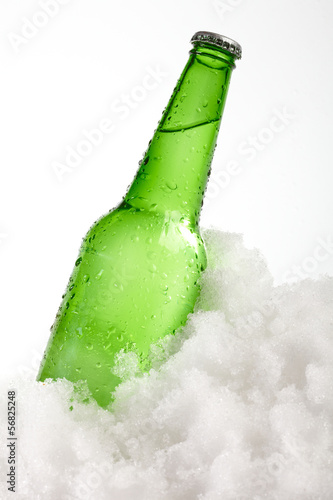 beer bottle in snow