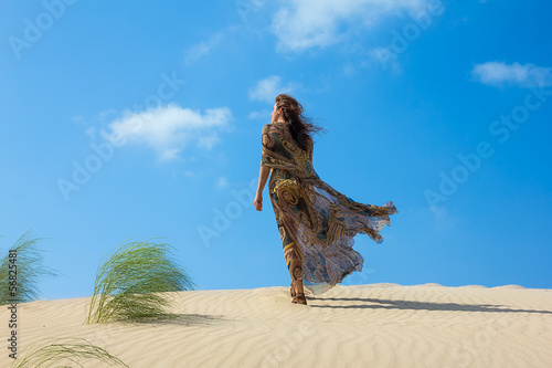 Beautiful Woman on the Sand Dune. Oasis of Calm