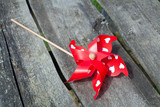 red pinwheel on wooden surface