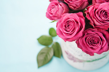 Bouquet of beautiful pink roses on light blue background.