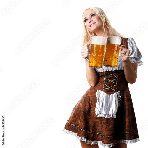 woman in tiroler oktoberfest style with aglass of beer