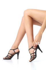 Woman with beautiful legs touching the heel of the foot