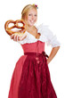 Happy woman offering pretzel