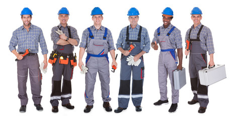 Group Of Plumber With Tools