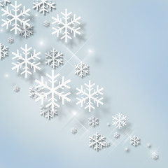 Abstract Christmas blue background with snowflakes that glow