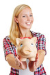 Young happy woman holding piggy bank
