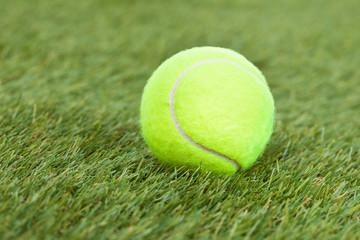 Tennis Ball On Green Pitch