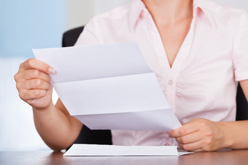 Businesswoman With White Envelope