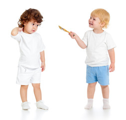 Baby boy with paint brush and girl standing full length isolated