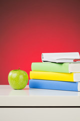 An Apple and Textbooks