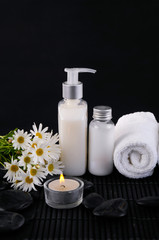 towel, massage oil ,zen ,candle ,stone on mat