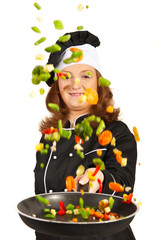Woman chef tossing vegetables
