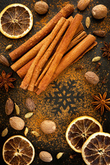 Christmas spices: cinnamon, cardamom, nutmeg on the chalkboard