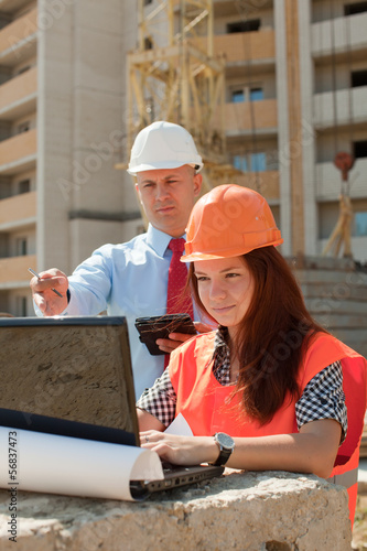 White-collar workers works on the building site