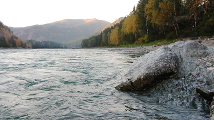 Large stone on the bank of a Katun river in Altay, Russia