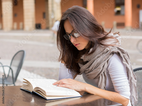 Beautiful girl reading a book on a spring day