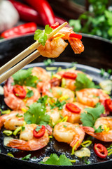 Tasting fried shrimp with fresh herbs