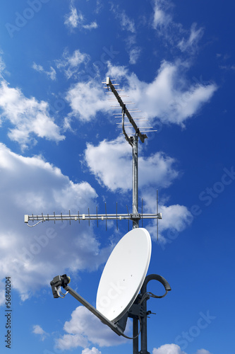 Satellite Dish and Antenna TV on Blue Sky