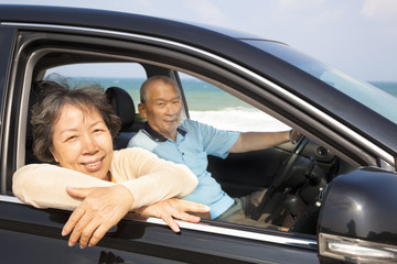 seniors couple enjoying road trip and travel