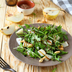 fresh salad with pear and arugula