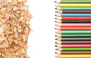 Colorful pencil border colorful pencil shavings on white backgro